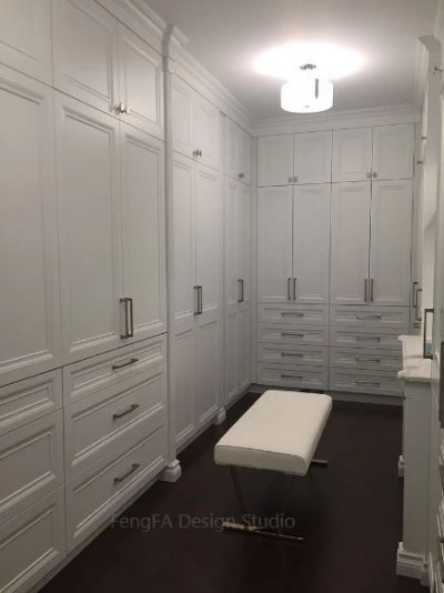 Walk In Closet with Cabinet and Drawer Combination