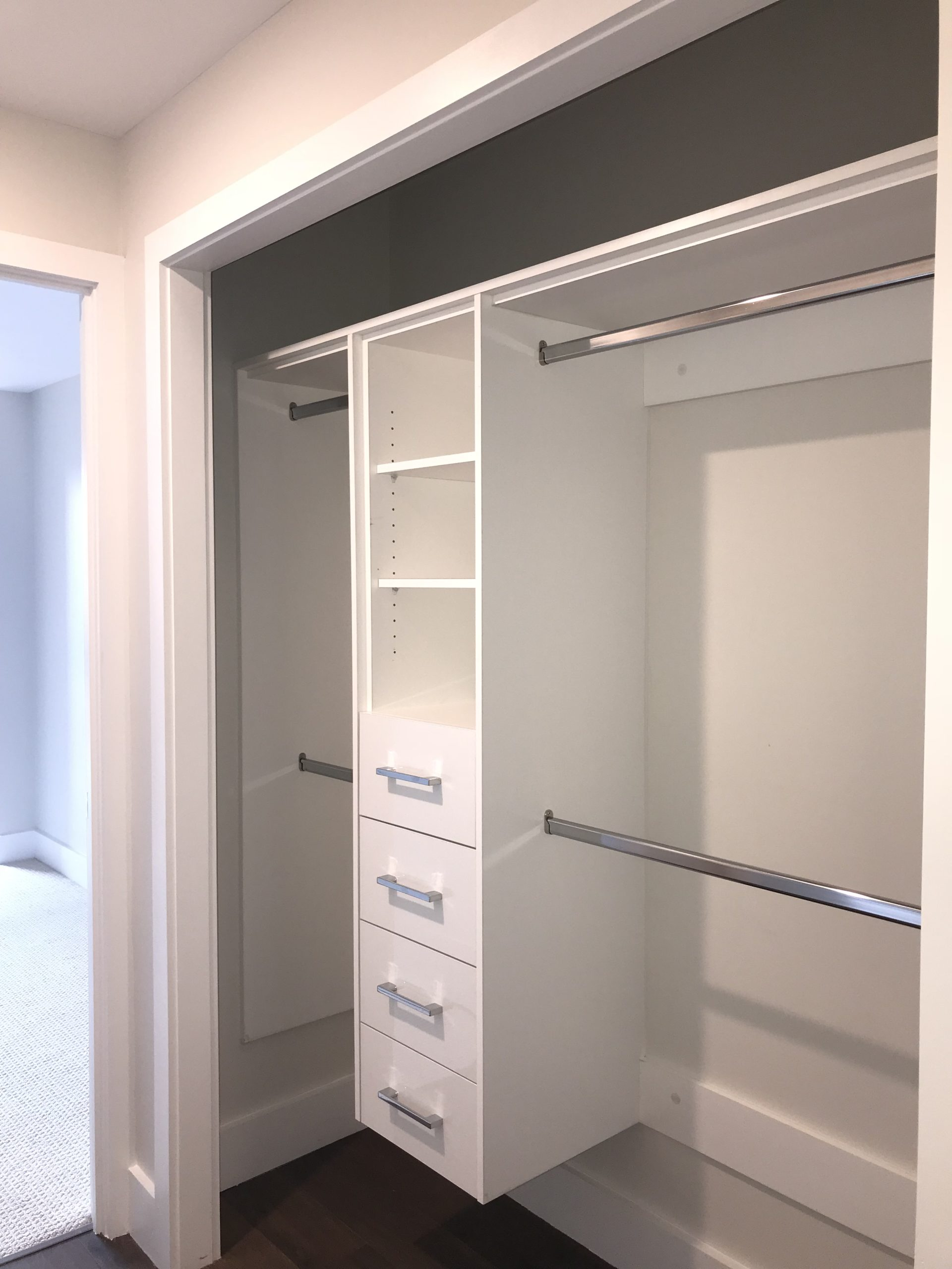 Central Cabinet Unit and Side Build In Coat Racks
