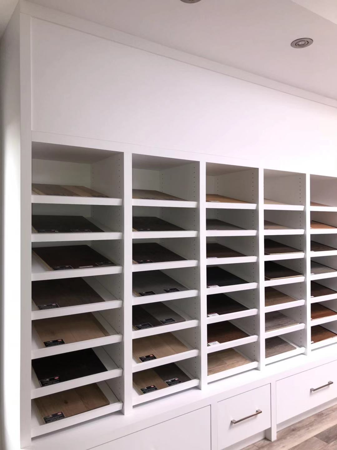 Divided Display Shelve Unit with Bottom Pull Out Drawers