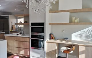Contemporary Kitchen Featuring Wood Grain Finishes, Handle-Less Design, and Corner Floating Shelf