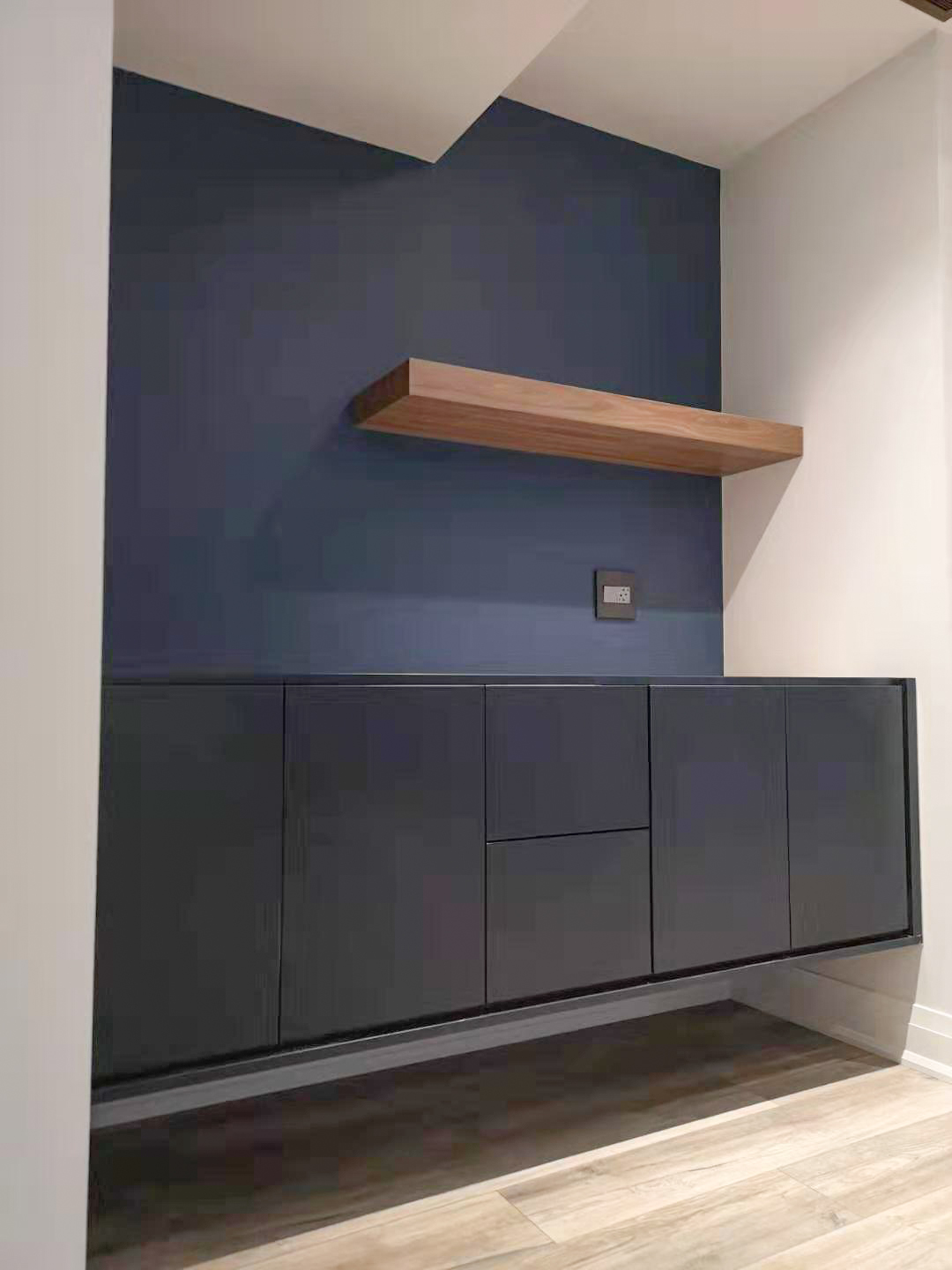 Blue wall unit with floating shelf