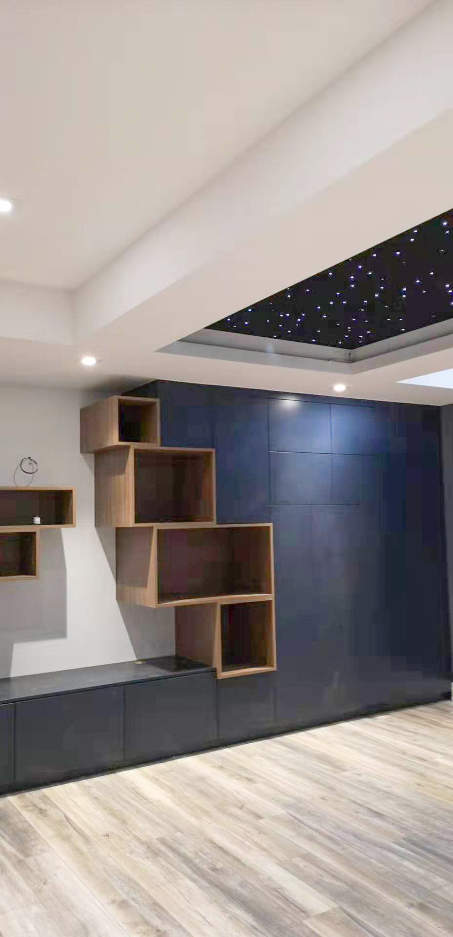 wall unit in painted blue and wood box